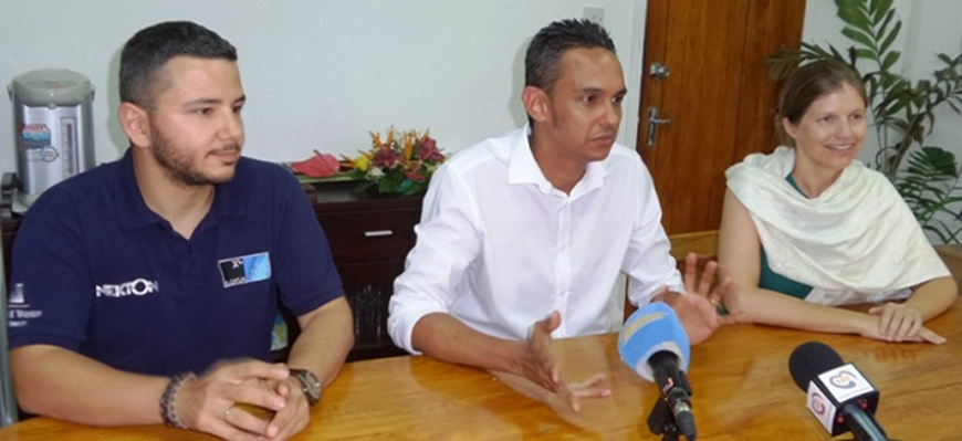 Team leader Stefanoudis, principal secretary Decomarmond and principal scientist Woodall in a meeting with the press last year. (Seychelles Nation) Photo License: CC-BY